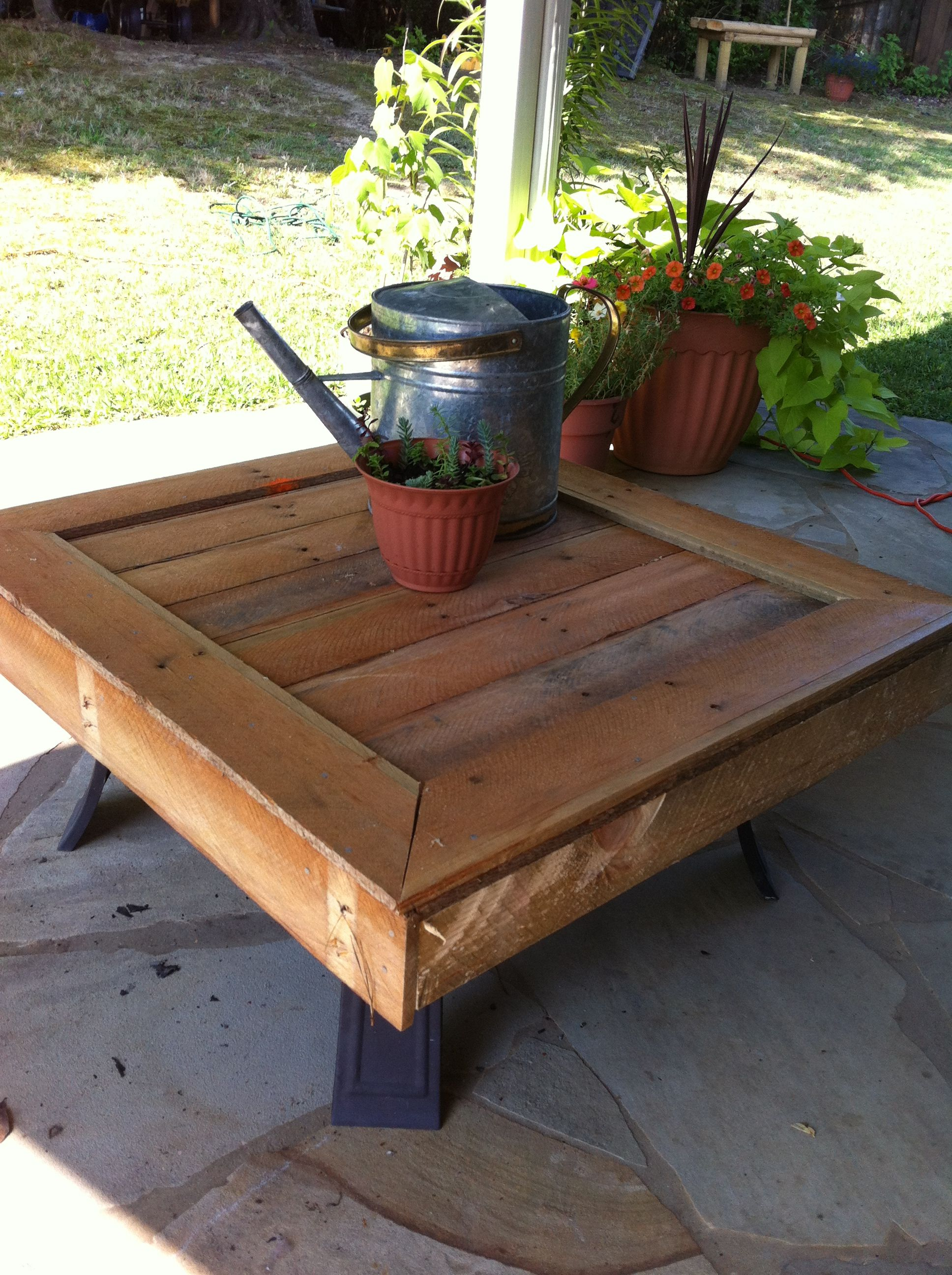 Table top made out of pallet wood to place over fire pit for Pallet fire pit