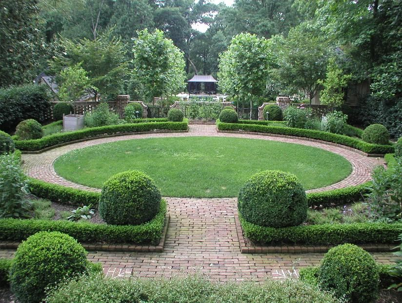 hedges circular lawn brick path and wall garden landscape designlandscaping