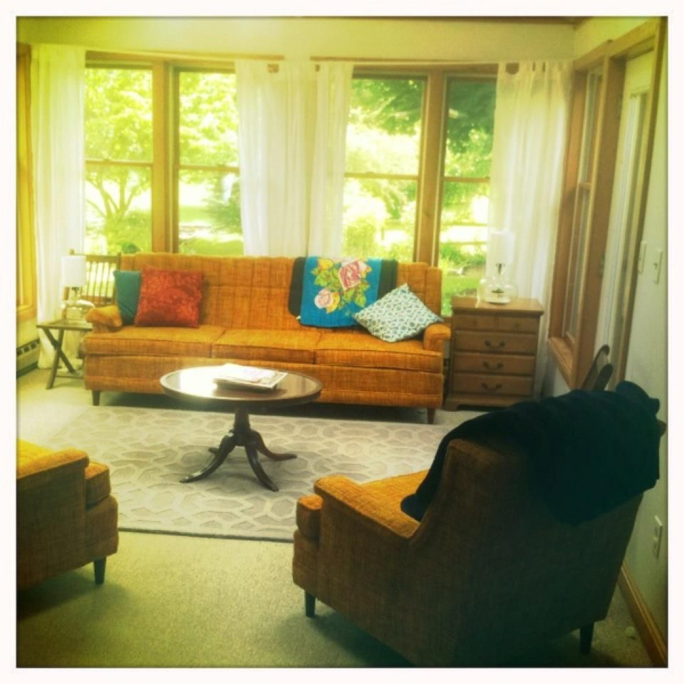Our sunroom. This vintage couch with matching armchairs