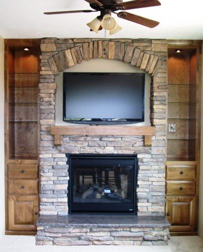 Stone Fireplace With Space For A Tv Above With An Arch
