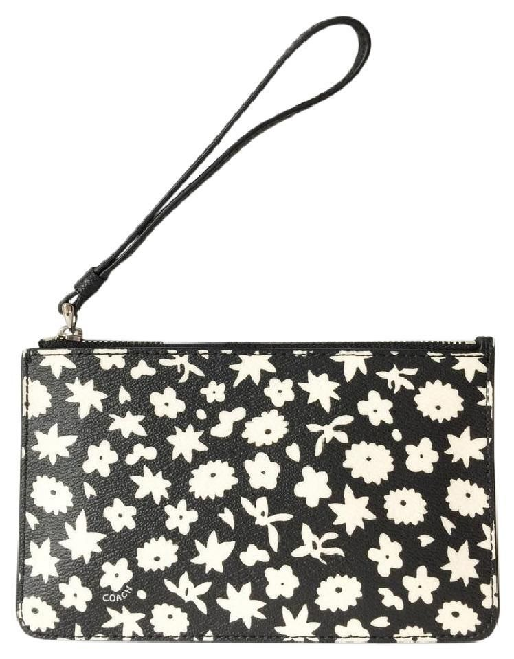 f654a526a19 Get the trendiest Clutch of the season! The Coach Floral Print Black And  White   Silver Wristlet is a top 10 member favorite ...