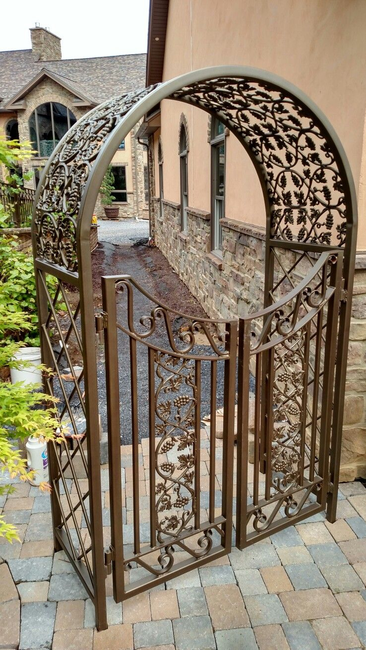 Custom Made Wrought Iron Arbor With Gates To Match The Wrought