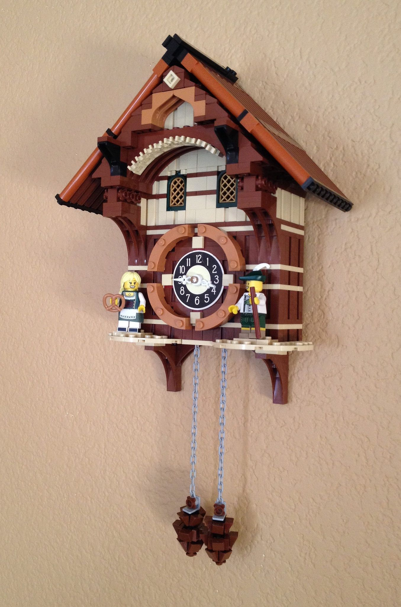 https://flic.kr/p/zMdEv2 | Cuckoo Clock | Have wanted to build one of these for quite some time. Since I had a busted up plastic cuckoo clock, I reused the clock mechanism and gave it new life in Lego form. There is no birdie and the pine cones are purely ornamental, but the clock does keep time.  If you like this clock. Feel free to visit Nick Tatar's Black Forest Cuckoo Clock. www.flickr.com/photos/43138245@N07/albums/72157632550040912 and you can support Nick Tatar's project on Lego…