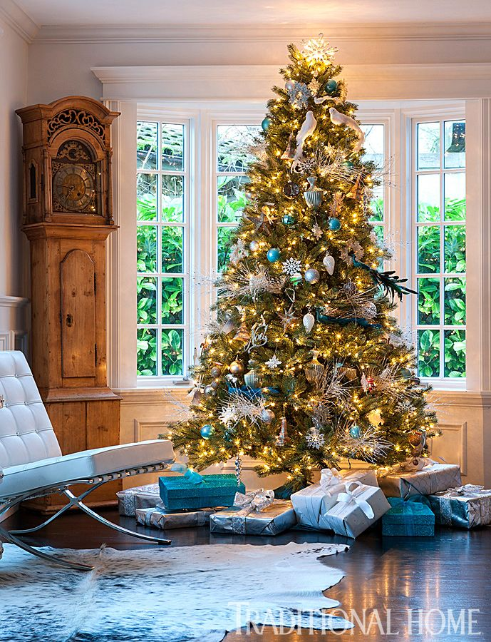 Presents under the tree are wrapped in colors that coordinate with the blue and silver ornaments. - Photo: John Granen / Design: Kristi Spouse