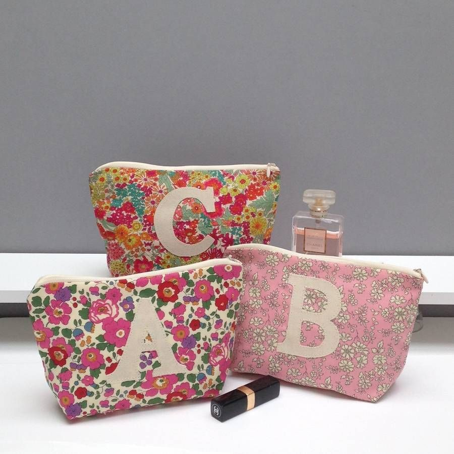 Our Hand Made Liberty Print Make Up bags are personalised with a single contrasting initial.Our make up bags are available in three classic Liberty prints. A: Betsy B: Capel C: Margaret Annie. We can make this in an initial of your choice.Made in Liberty of London Tana Lawn 100% cotton Gemima London make-up bags are individually appliqued in our London Studio. A stylish accessory and a beautiful personalised gift for any girl friend, mum, aunt or daughter. Perfect for carrying make-up, ...