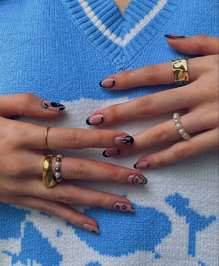 Black fire nails with cute jewelry