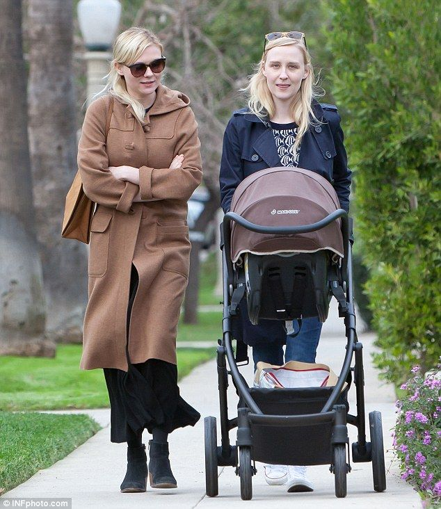 Baby It S Cold Outside Kirsten Dunst 32 Joined Her Friend And Her Friend S Baby For So Kirsten Dunst Style Kirsten Dunst Long Brown Coat