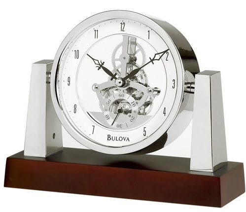 Solid wood base, dark mahogany finish. Chrome-finish pivoting clock housing and supports.