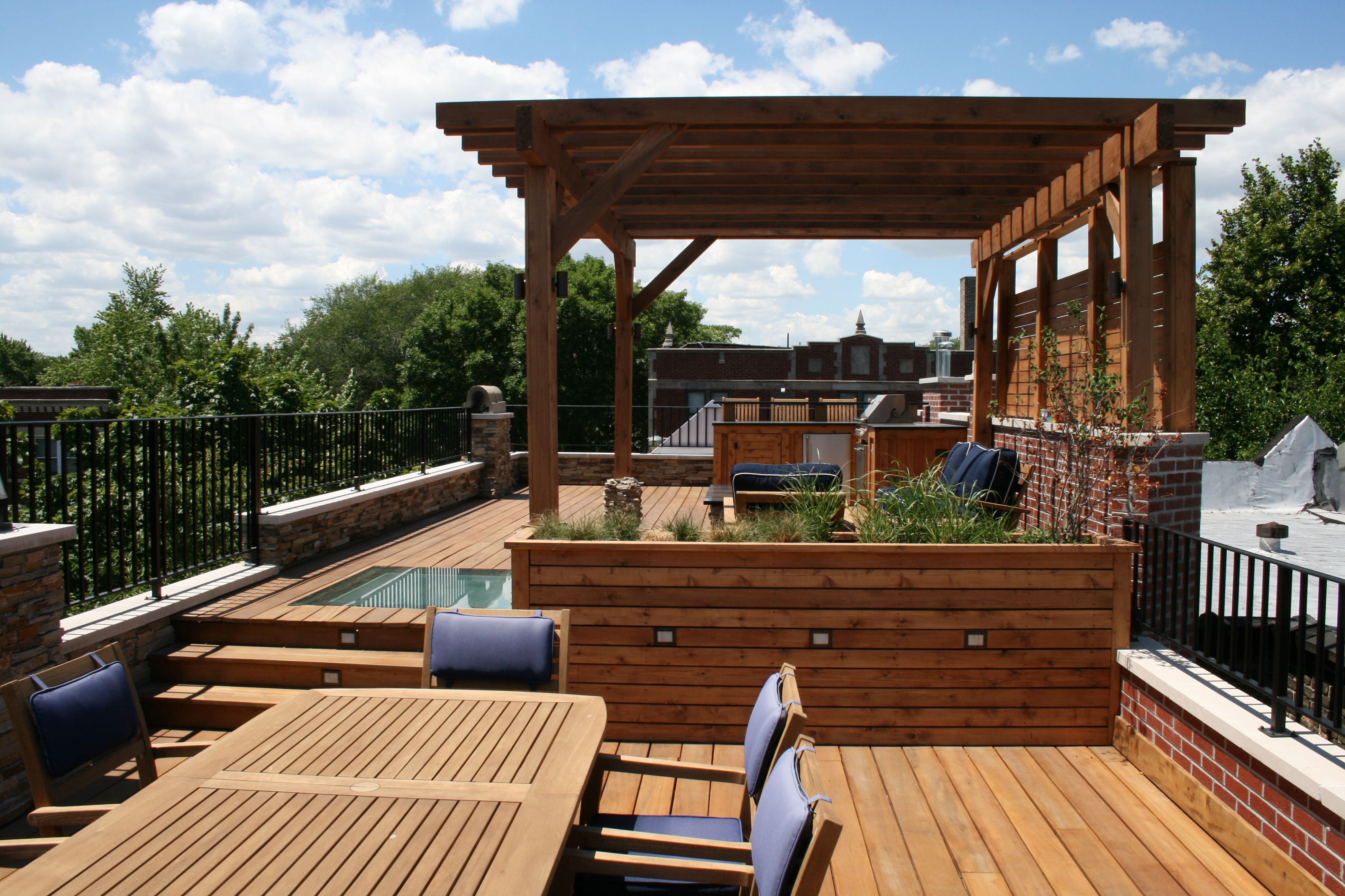 This Chicago Rooftop Features A Cedar Pergola With Lounge Seating And Fire Pit As Well Built In Grill Bar Area Dining Space