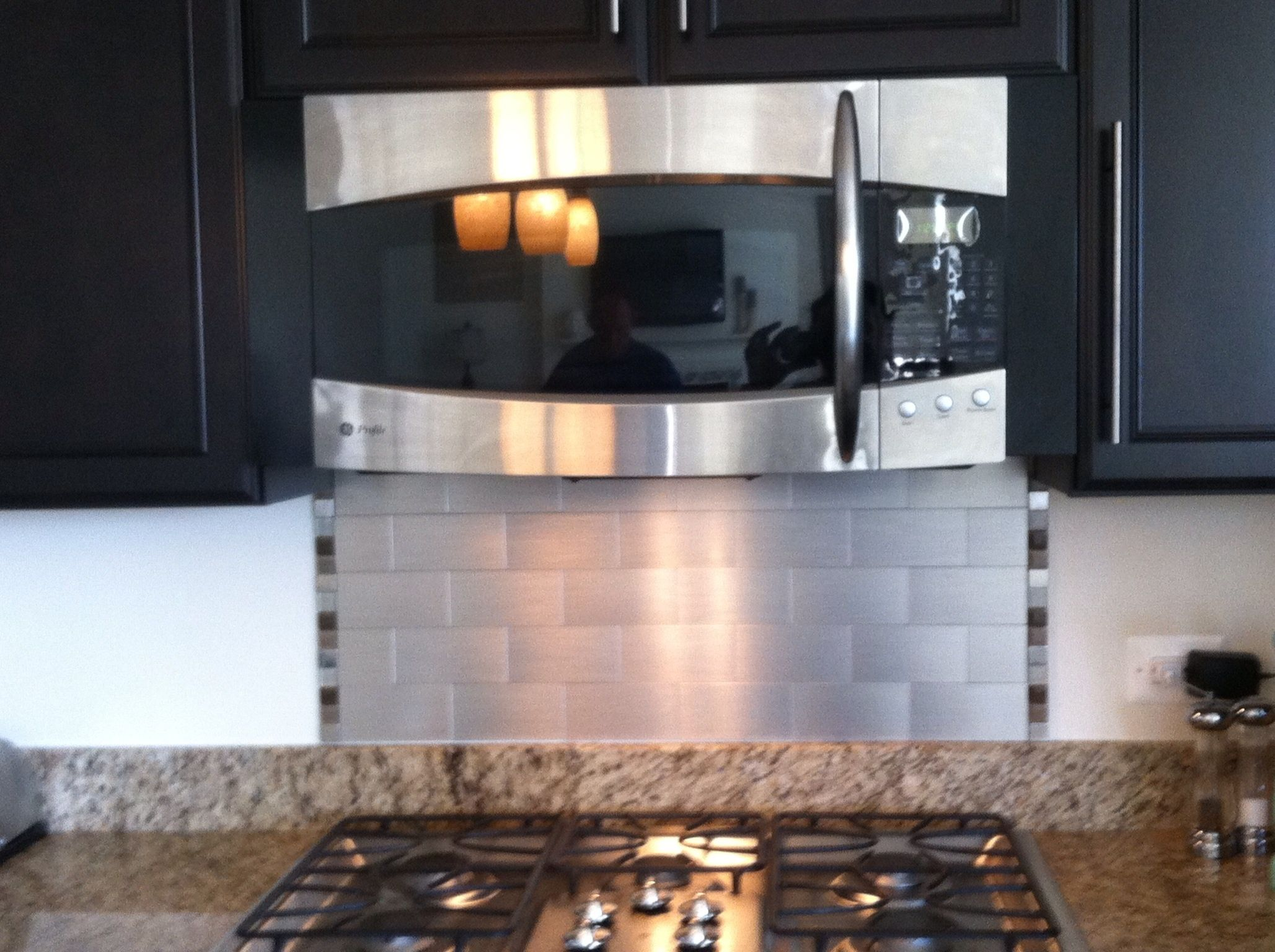 After! Simple and modern backsplash! A great DIY project on a budget.