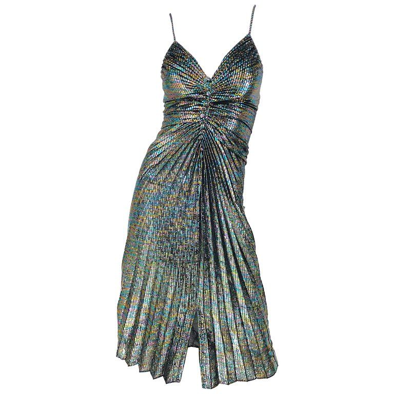 d453be585 For Sale on 1stdibs - Amazing 1970s SAMIR rainbow metallic pleated slinky  sleeveless disco dress! Features a rainbow of colors throughout.
