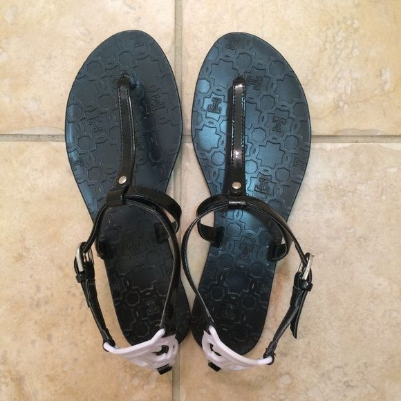 Ivanka Trump Black Sandals Ivanka Trump black and white T-strap sandals. In excellent condition, only worn a few times. Only real signs of wear are on bottom of shoes pictured. Ivanka Trump Shoes Sandals