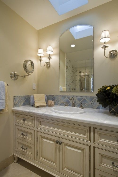 Pretty vanity cabinet and tile backsplash Bathroom ideas