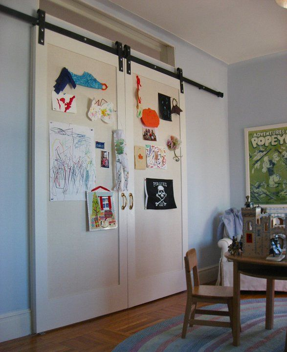 Adorable kids room with light blue walls and sliding barn doors pinned with homemade art. & Adorable kids room with light blue walls and sliding barn doors ...
