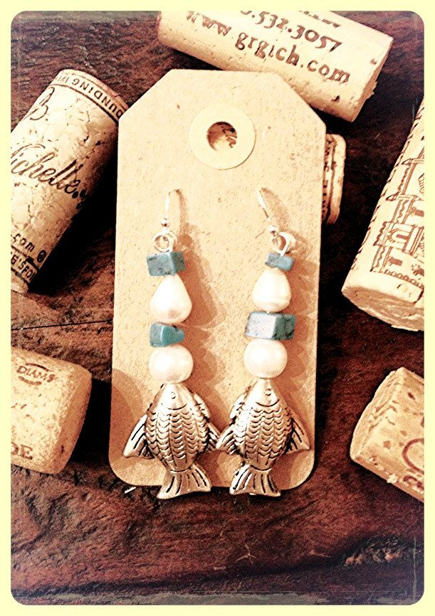 Sterling silver earrings with  freshwater pearls, turquoise finished off with pewter fish. $20.00, via Etsy.