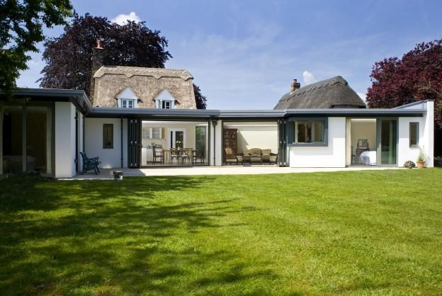 A large single storey extension to this thatched cottage for Cottage extension designs