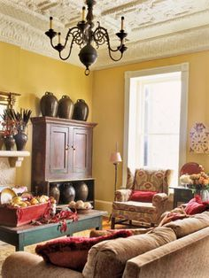 Yellow walls cream colored built in and eventually trim either aqua red or orange curtains also living room decorating ideas you  ll love rh pinterest