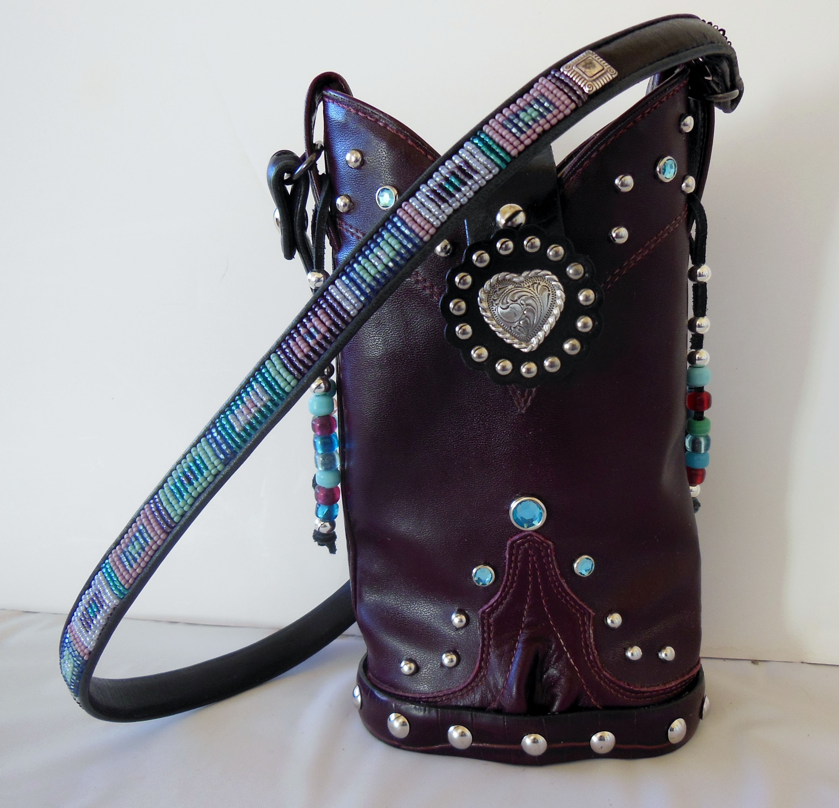 """Sweet aquamarine jeweled StageCoach Bag designed and created from vintage cowboy boots and vintage belts.  This is a beaded Brighton belt created into a carrying strap.  www.stagecoachbagsandcollectibles.com   Each bag is """"One of a Kind"""", handcrafted, leather, numbered and named, bio cards available for each bag"""