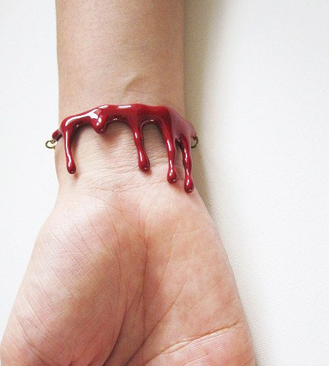 Cool and Spooky bleeding blood bracelet. The jewelry is made in round shape to fit with all wrist joint with golden tone brass chain, so it can