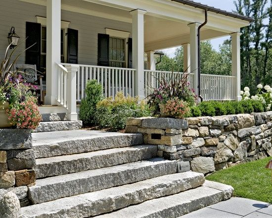 Stone retaining wall with stone slab steps how does your for Front porch designs with stone