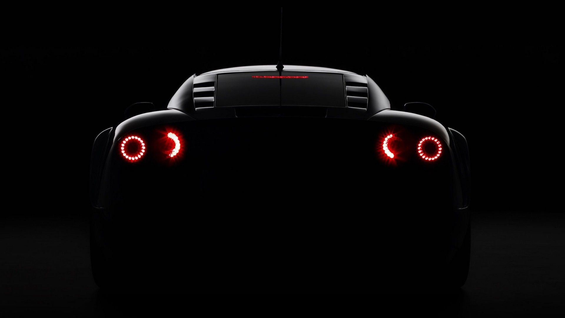 Noble M600 Dark Glowing Rear Angle View Sports Car Wallpaper