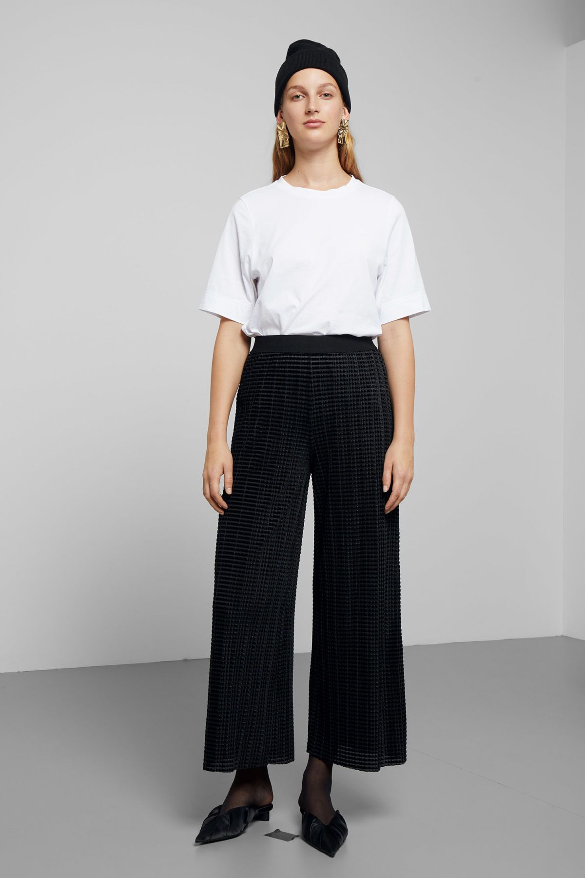 The Wassily Pleated Velvet Trousers are a pair of luxe palazzo trousers in  a dimensional structure 234813eff38d5