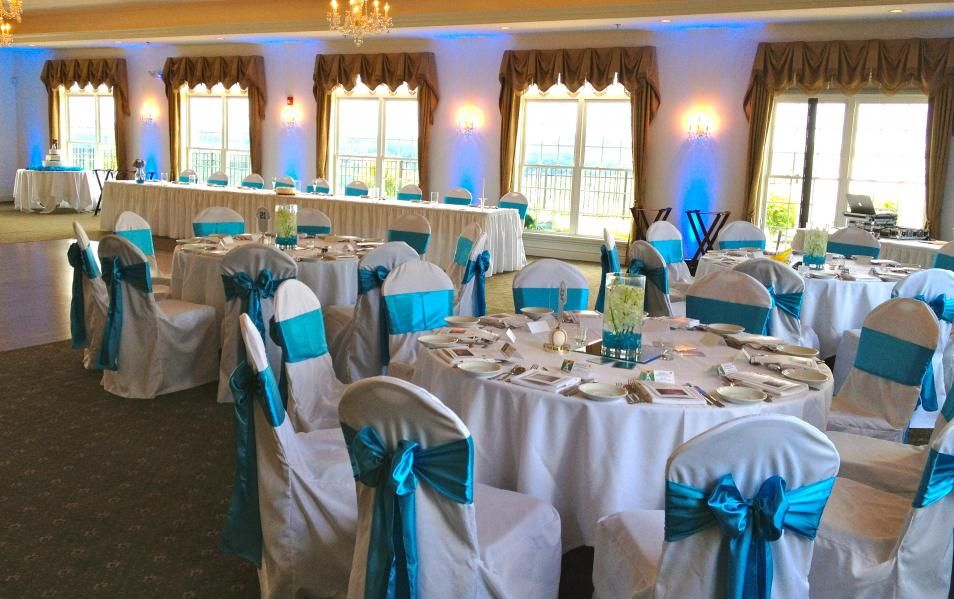 Deep sky blue wedding theme with matching blue up lights. DJ ...