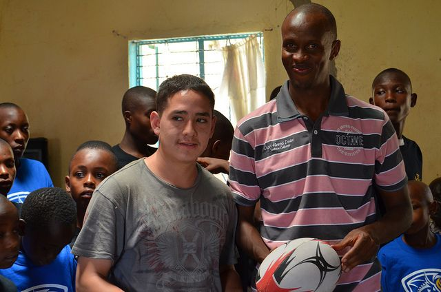 Cesar Presents Rugby Ball to church leader and Rotary Club of Machakos President by Other Paths.