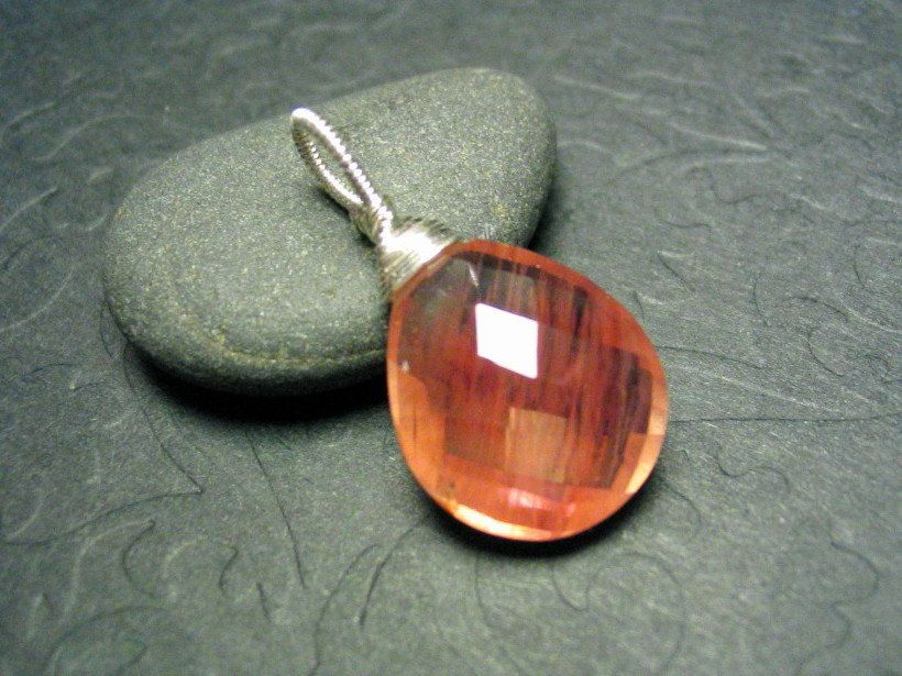 Peachy Oregon Sunstone Sterling Silver Wirewrap Gemstone Pendant. $55.00, via Etsy.