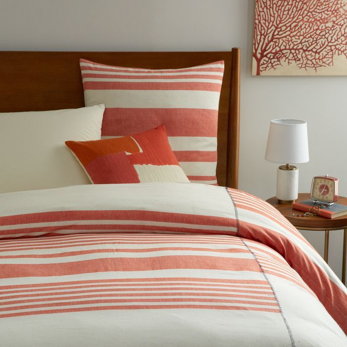 10 Must Have Decor Furnishings For Your Chic Apartment Bedroom Striped Duvet Covers One Bedroom Apartment Apartment Chic