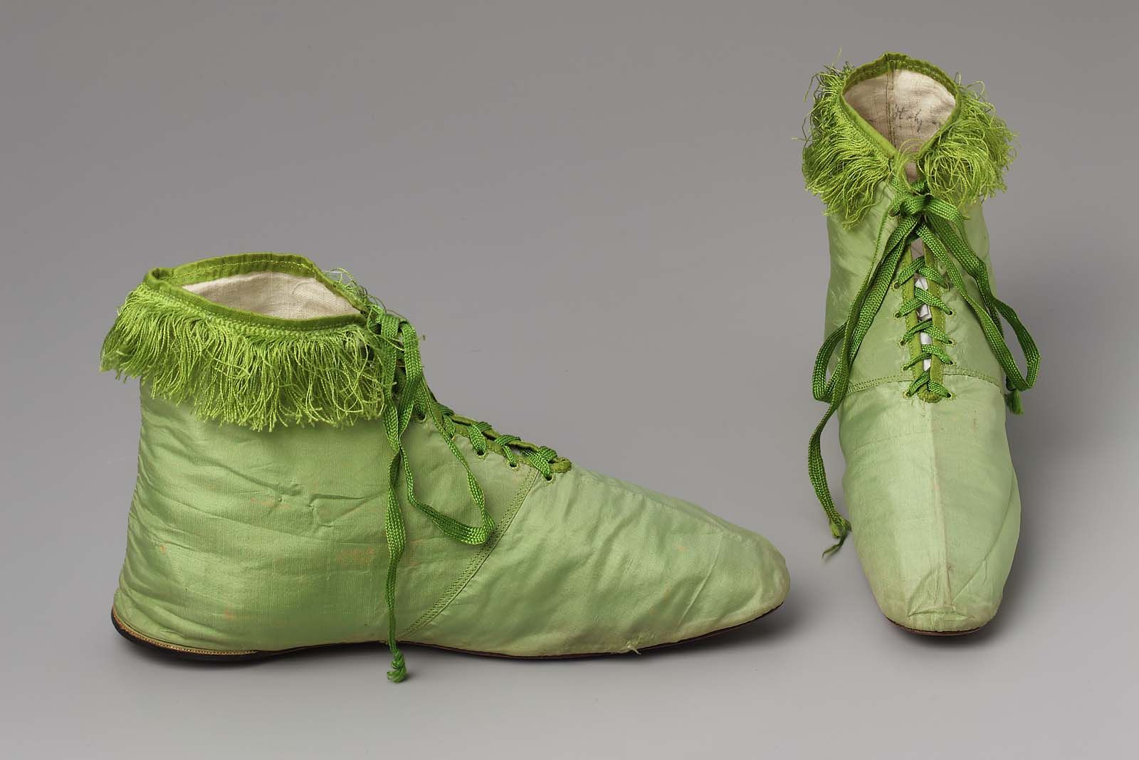 Woman's Silk Shoes from Florence, Italy ~ 1818 ~ Museum of Fine Arts, Boston ~ Chartreuse silk shoes with silk fringe around ankle and silk laces center front; leather soles, no heels, linen lining.