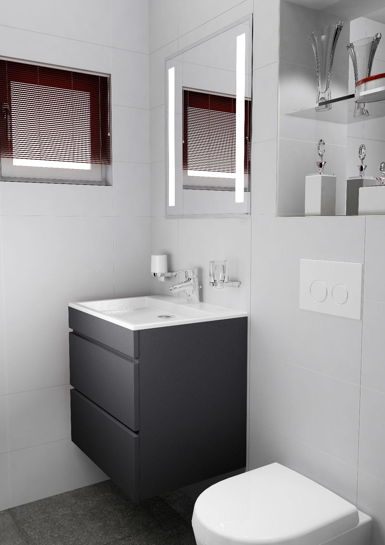 Kleine badkamer met wastafelmeubel en naast het inbouwreservoir ...