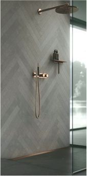 Photo of Bathroom accessories made of copper. Bathroom decor, ideas and inspiration. Show…