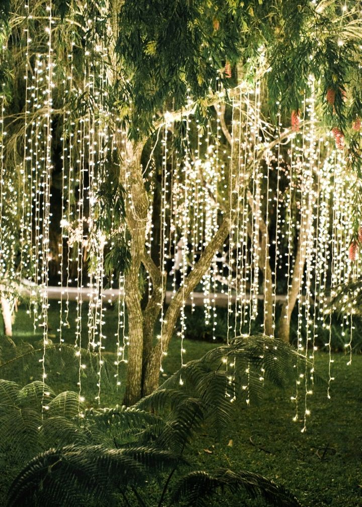 Cozy and romantic outdoor wedding decor with hanging lights