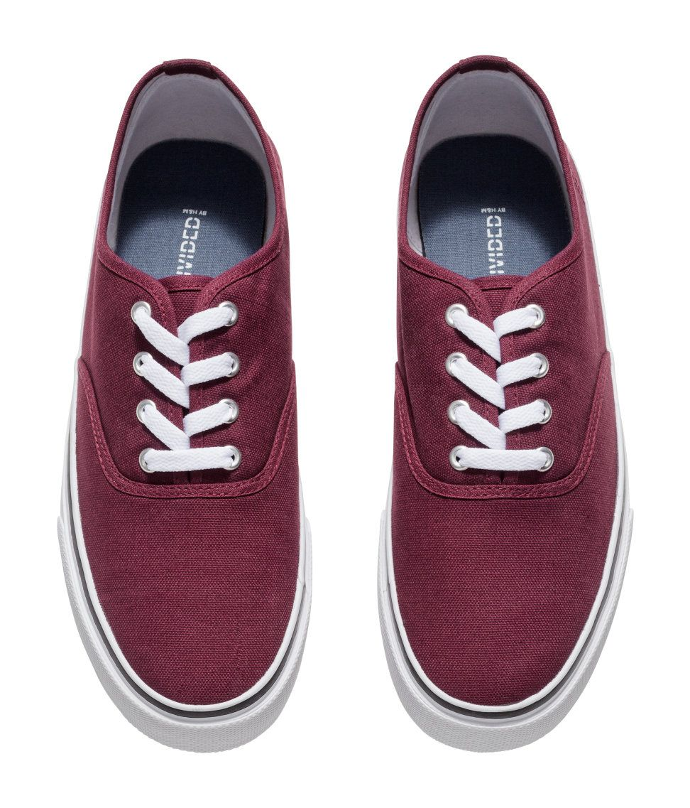 4ac77f3c8a3c Burgundy lace-up canvas sneakers for a confident touch.