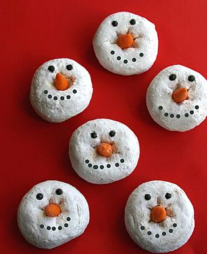 DIY Snowmen Donuts. Donuts, chocolate chips (or black paint pen or icing), candy corn (or carrots). Image and comments from Creative Gift and Party Ideas here.