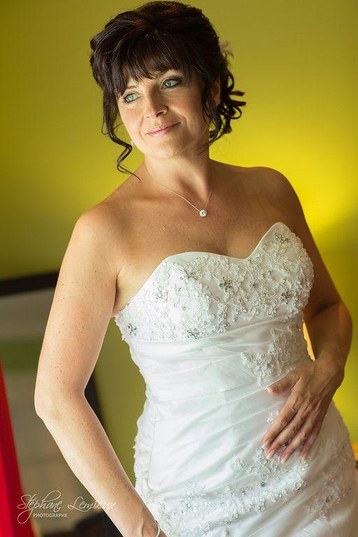 Beautiful bride wearing white wedding dress.