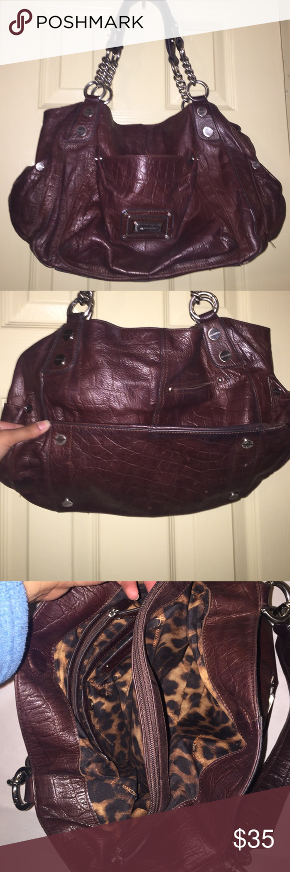 B.MAKOWSKY LEATHER PURSE In good condition, all leather, has side pockets and a front pocket, 3 divisions inside, has that small white paint on the handle and a bit in the corner. Please carefully review each photo before you purchase. Since this is the best description for the item. b. makowsky Bags