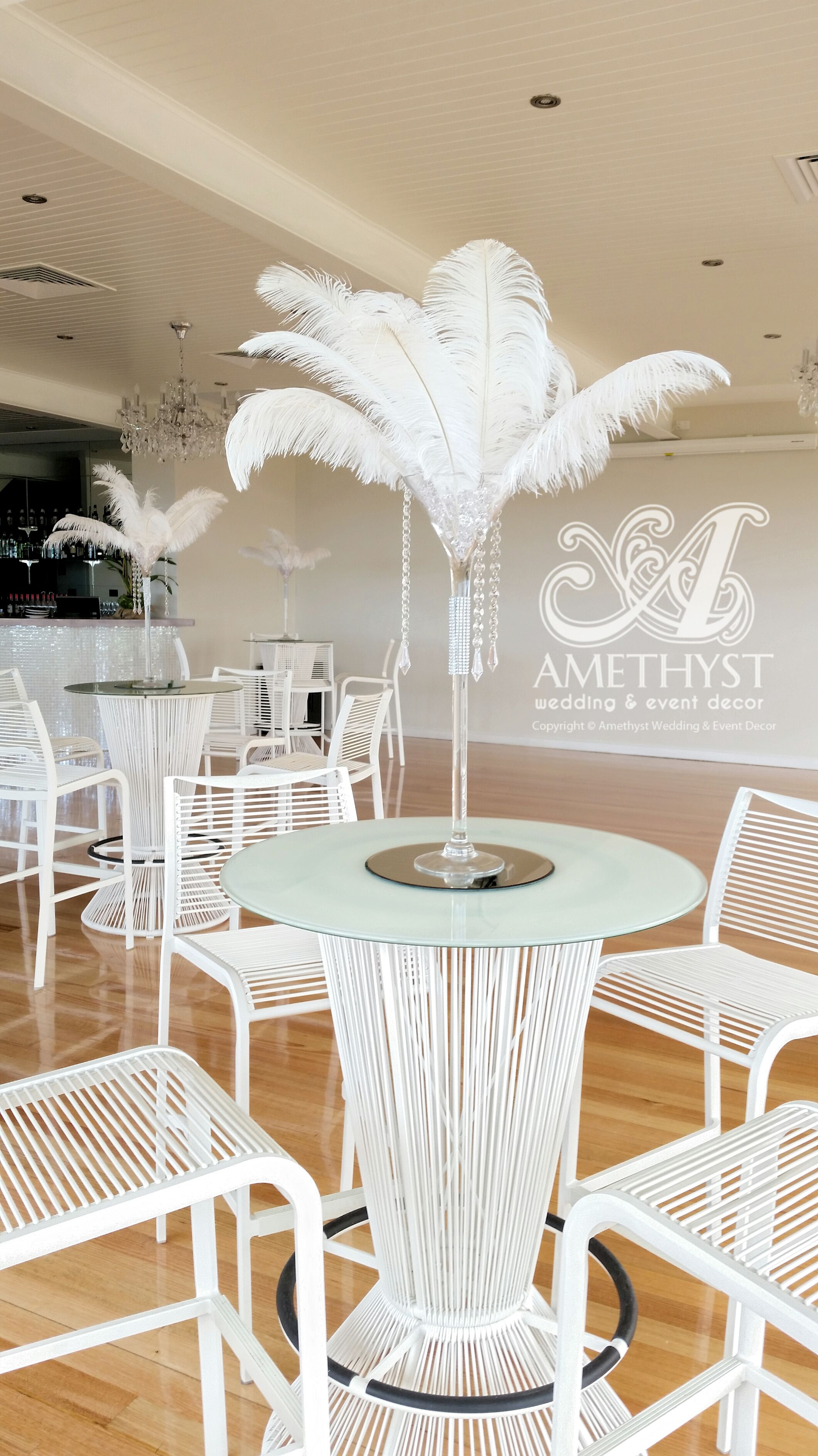 White wedding modern decor. Crystal feather martini centerpieces ...