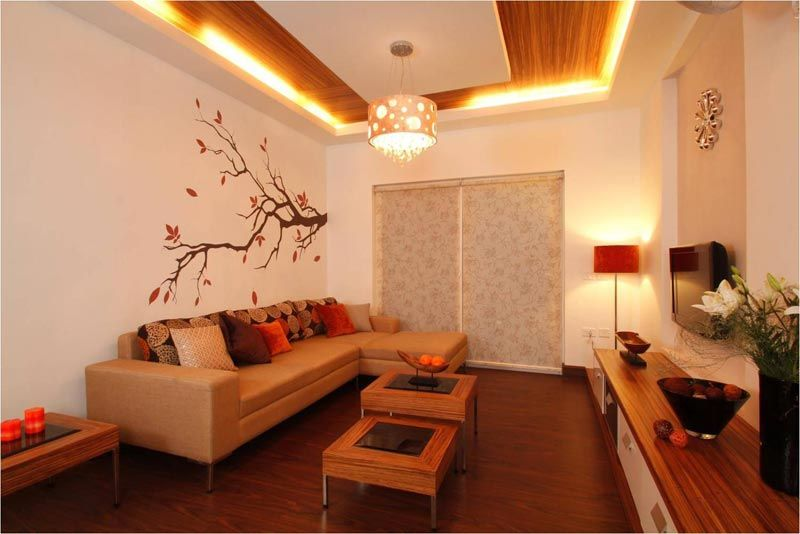 Living room with wooden ceiling savio and rupa interior for Living room designs bangalore