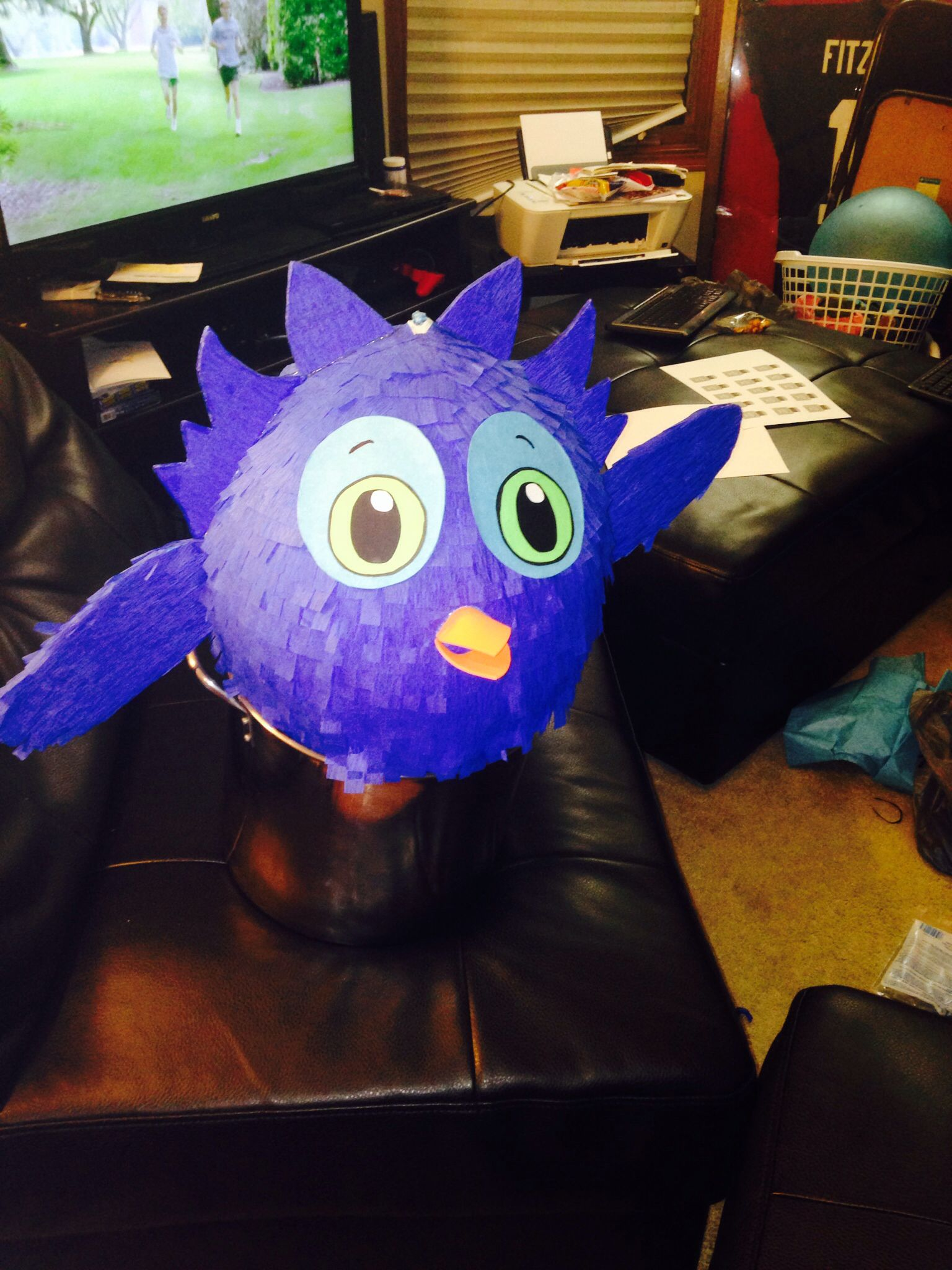O the owl piñata made out of paper mâché.