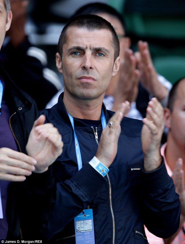 Clean shaven: Liam Gallagher unveiled his dramatic crop at the Australian Tennis Open, in Melbourne
