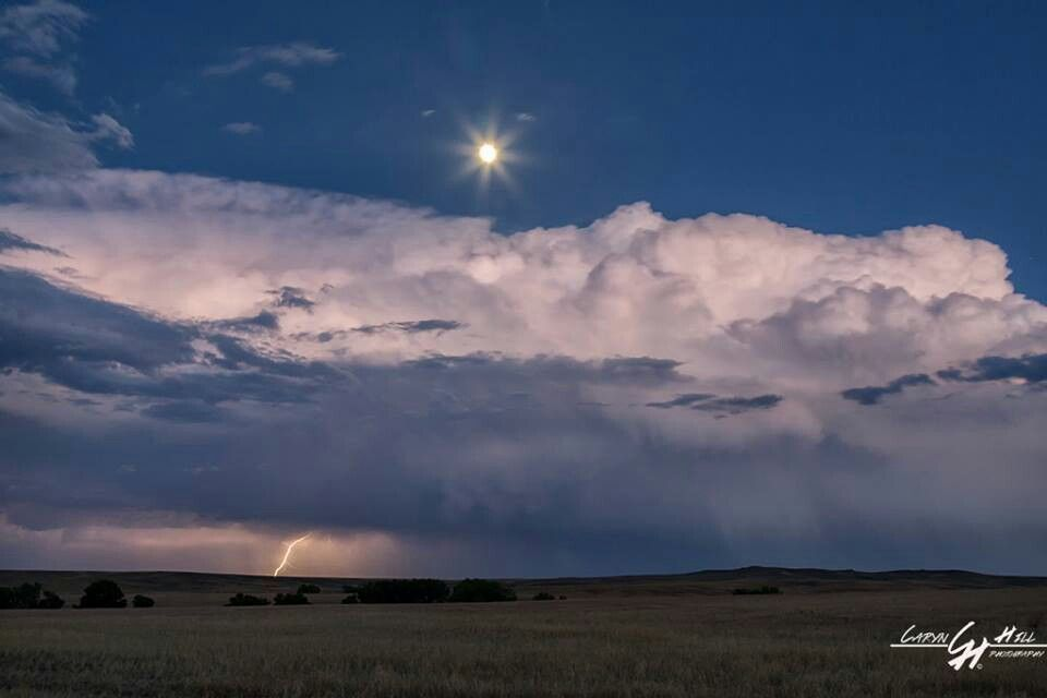 Moon rising over severe storm..
