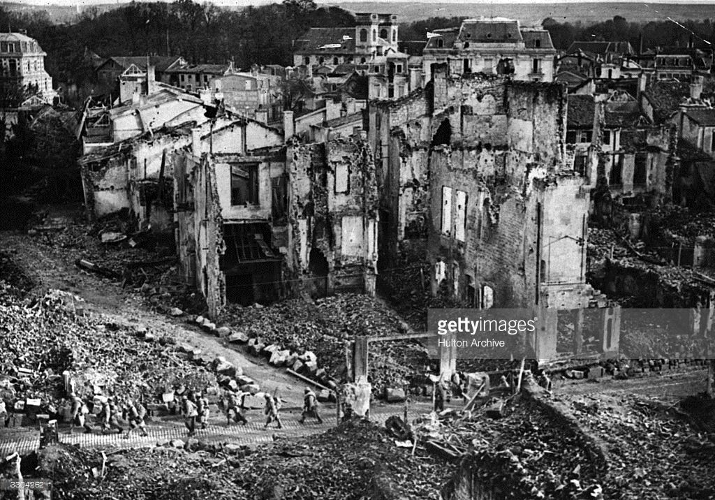French troops passing through ruins at Verdun.