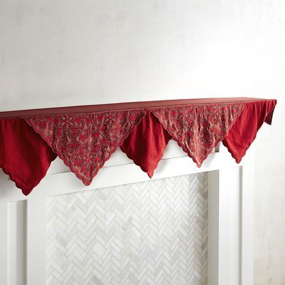 With its classic red color and intricate glass bead detailing, this is a mantel scarf that can adapt as your holiday style changes. One year, its scalloped hem fits right in with your ornate gold or silver mantel decor; the next year, you may go more rustic with wood accents and candles, or cottage chic, or—you get the idea. It's all good, well, actually great.