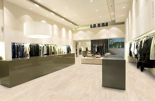 White-washed cork floor illuminating retail space.