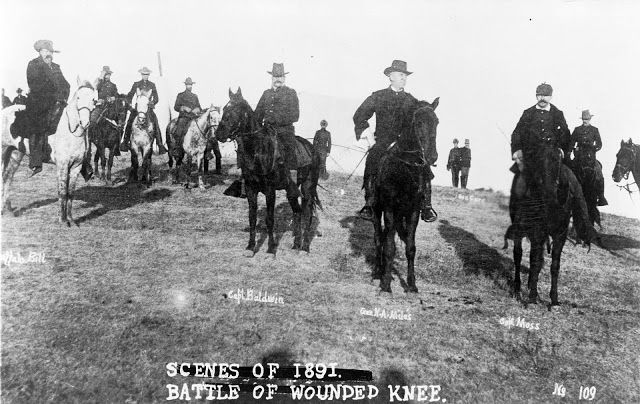 Buffalo Bill, Capt. Baldwin, Gen. Nelson A. Miles, Capt. Moss, and others, on horseback, on battlefield of Wounded Knee.