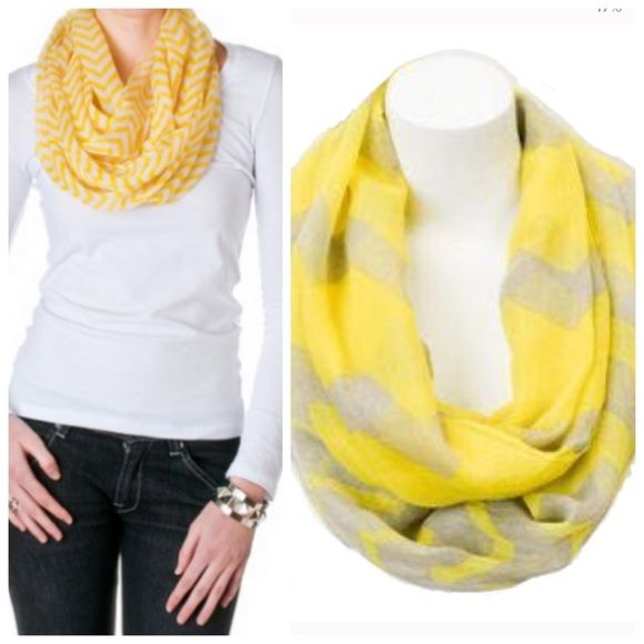 Yellow/Gray chevron scarf 4 Available. There's no need to fear low temps or lackluster outfits while wearing this stylish infinity scarf! Boasting a playful chevron pattern and swoon-worthy softness, it makes ensembles come alive, while shivers don't stand a chance.  24'' W x 36'' circumference 100% viscose Accessories Scarves & Wraps