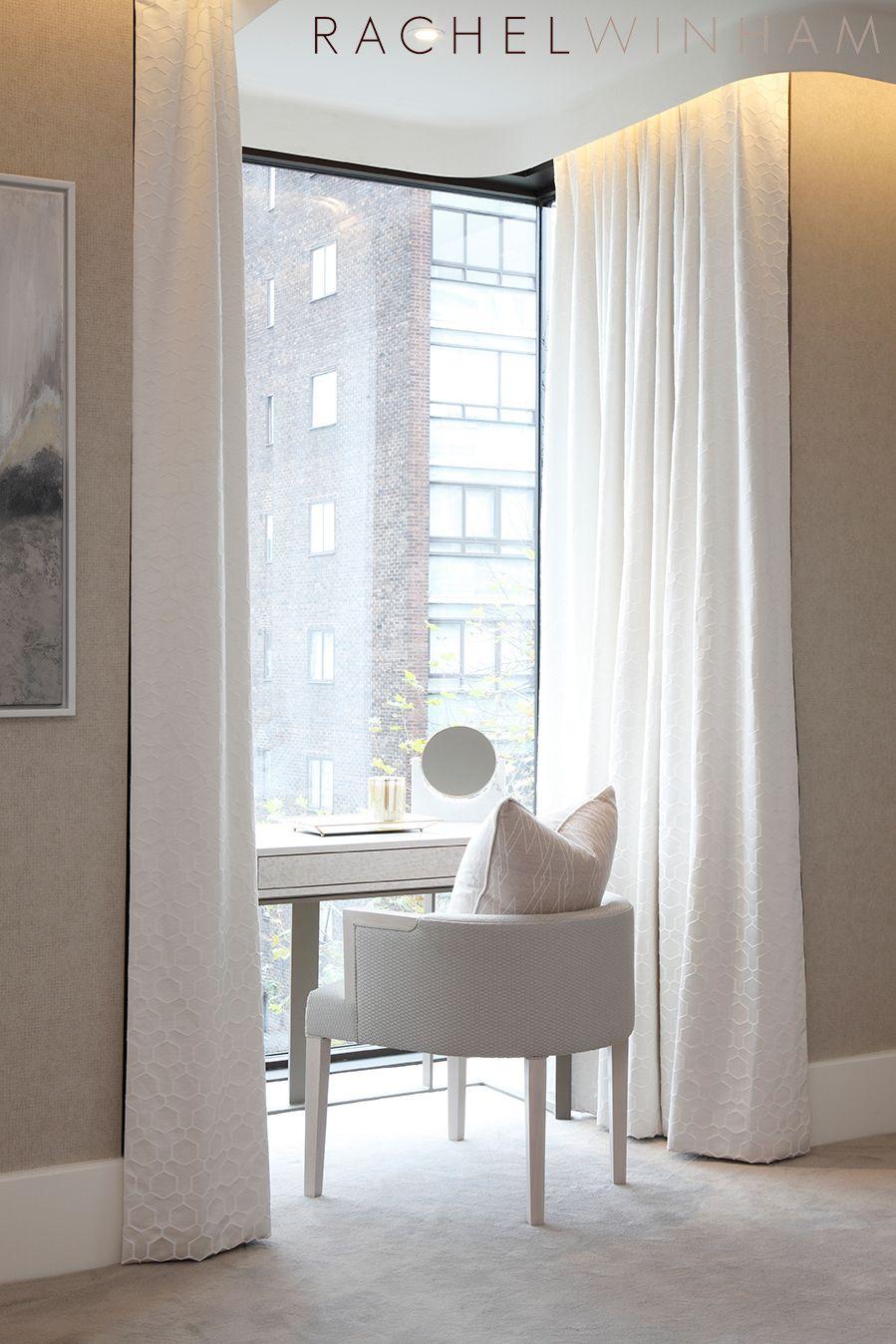 Under window decor  window deskvanity niche framed in light draperies for soft texture