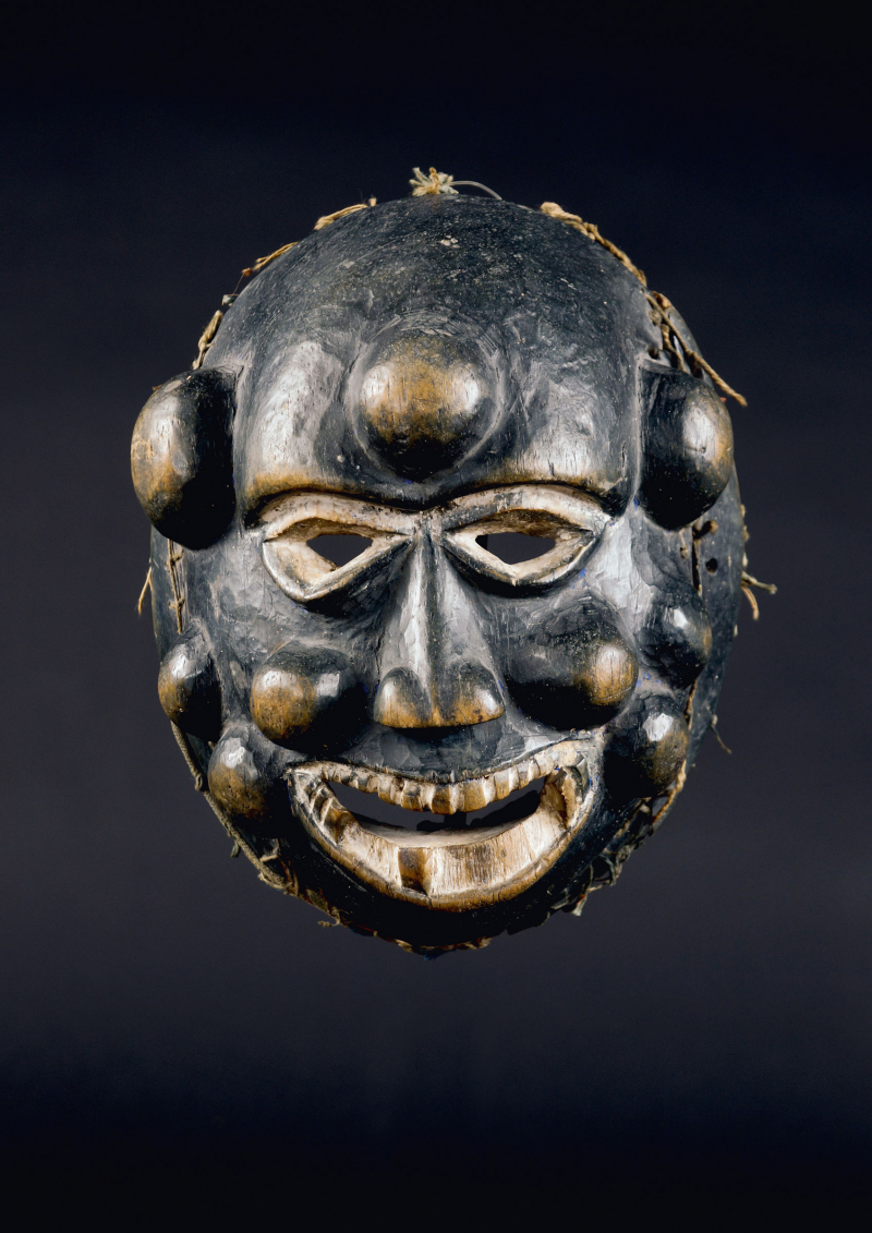 Nigeria. Ibibio. Sickness mask of a face marked with smallpox.